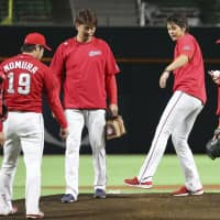Carp pitchers test the Yafuoku Dome mound on Monday ahead of Tuesday's scheduled Japan Series Game 3.   KYODO