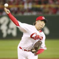 Carp starter Daichi Osera pitched five innings in the series opener. | KYODO