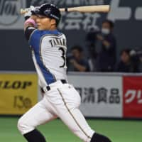 The Fighters' Kensuke Tanaka strokes a tiebreaking single in the first inning against the Marines on Thursday at Sapporo Dome. Hokkaido Nippon Ham edged Chiba Lotte 5-4. | KYODO