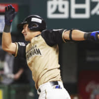 Nippon Ham outfielder Taishi Ota doubles home the go-ahead run in the eighth inning against the SoftBank Hawks on Sunday at Yafuoku Dome. The Fighters won 4-2 and forced a decisive Game 3 of the PL Climax Series' first stage on Monday. | KYODO