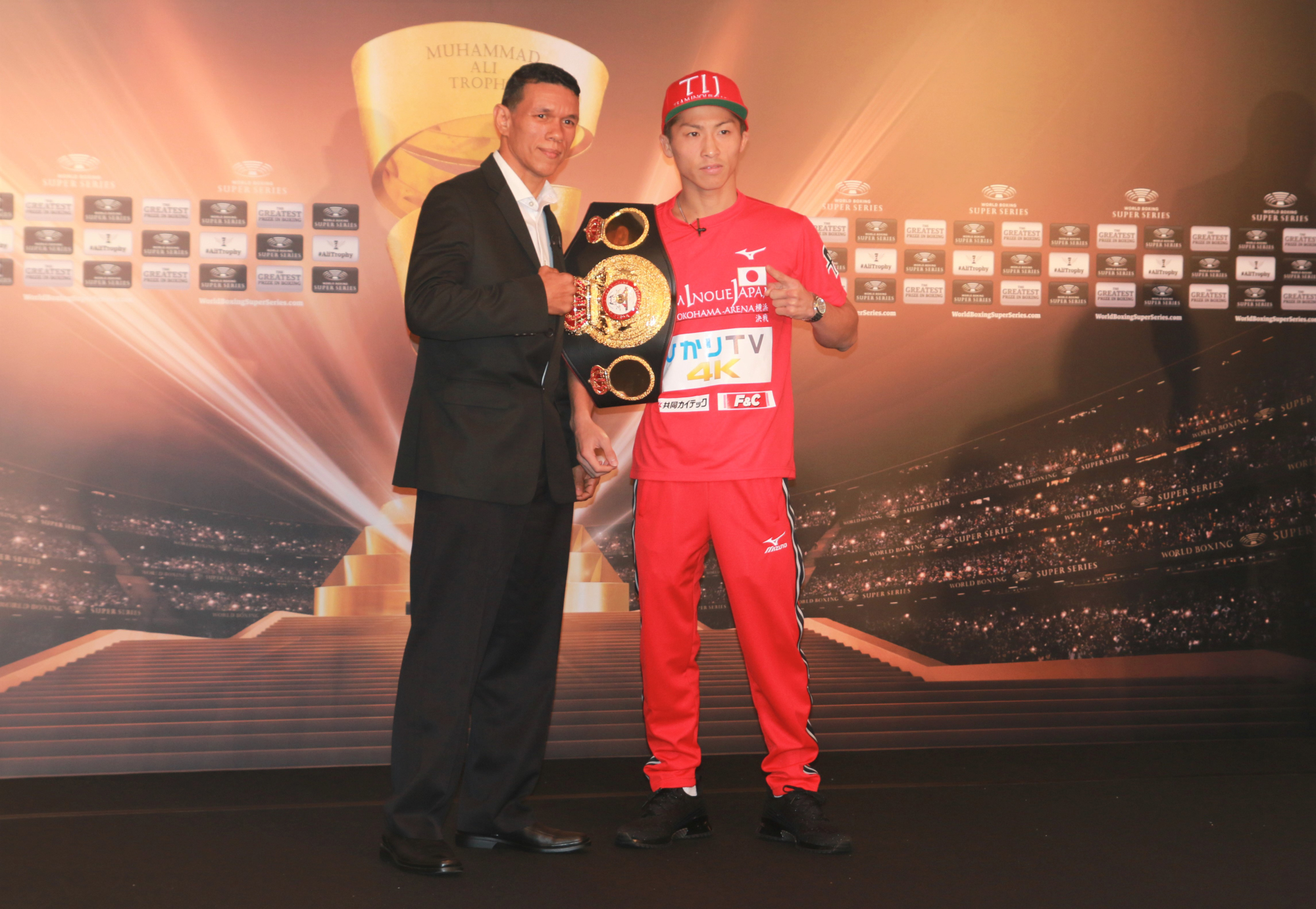 WBA bantamweight champion Naoya Inoue (right) and Dominican challenger Juan Carlos Payano are seen at a news conference on Friday to promote their upcoming World Boxing Super Series fight.   KAZ NAGATSUKA