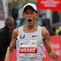 Suguru Osako reacts after finishing third in the Chicago Marathon on Sunday. British athletics star Mo Farah won the men's title on Sunday in an unofficial time of 2 hours, 5 minutes and 11 seconds. | AFP-JIJI