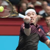 Kei Nishikori returns the ball against opponent Kevin Anderson during Sunday's Erste Bank Open final in Vienna. | KYODO