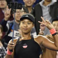 Naomi Osaka takes a selfie on Monday at the China Open in Beijing. | KYODO