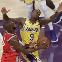 The Lakers' Rajon Rondo (9) defends Rockets guard Chris Paul on Saturday in Los Angeles. | AP