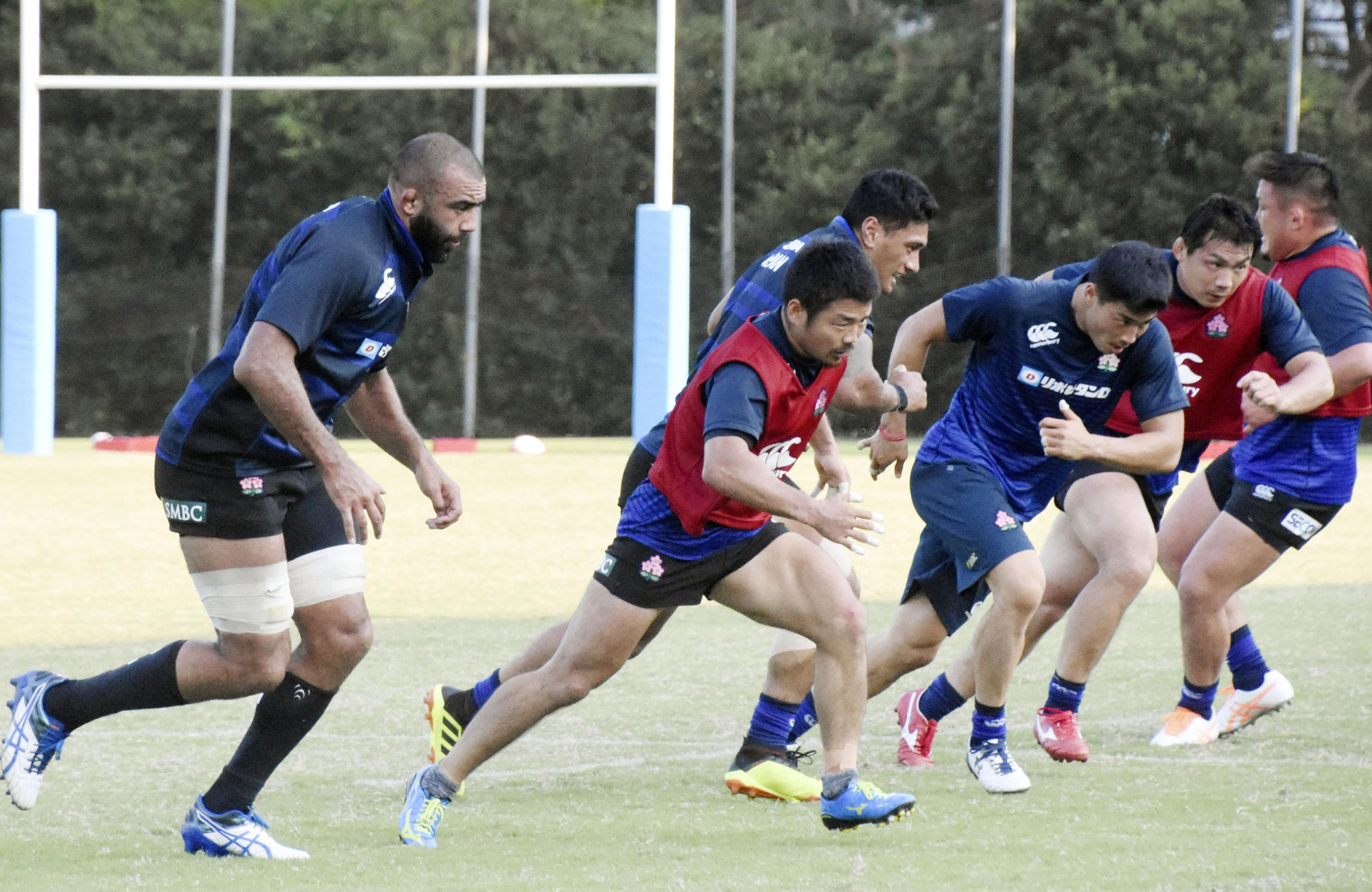 The Brave Blossoms train in Miyazaki on Oct. 18 ahead of their upcoming tests against a World XV and New Zealand. | KYODO