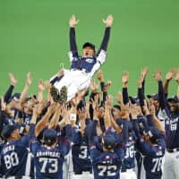 Lions manager Hatsuhiko Tsuji is given a doage (victory toss) after Seibu's game against the Fighters on Sunday in Sapporo. Seibu clinched the PL pennant despite losing the contest. | KYODO