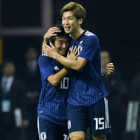 Japan's Yuya Osako (right) celebrates with Shoya Nakajima after scoring against Uruguay during their friendly on Tuesday in Saitama. | AFP-JIJI