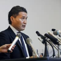 Takanohana speaks during a news conference on Sept. 25. The former yokozuna's resignation from the Japan Sumo Association was officially accepted on Monday.   KYODO