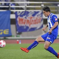 Montedio's Toyofumi Sakano scores his team's third goal during the J2 side's 3-2 upset of Frontale in the Emperor's Cup quarterfinals on Wednesday in Tendo, Yamagata Prefecture. | KYODO