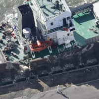A freighter slammed into a seawall in Kawasaki on Monday after Typhoon Trami hit the area.  | KYODO