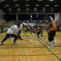 Participants play floor hockey during a national competition that was sponsored by FP Corp. in Katsushika Ward, Tokyo, on Oct. 20. | FP CORP.