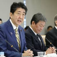 Abe orders Cabinet to mitigate impact of coming consumption tax hike