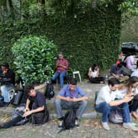 Journalists wait for a meeting between economist Paulo Guedes and the Brazil's new president-elect, Jair Bolsonaro, in Rio de Janeiro Oct. 30.   REUTERS