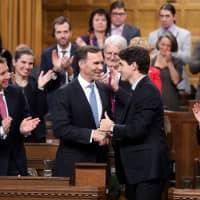 Trudeau cuts Canadian business taxes to keep pace with U.S. moves, deferring deficit reduction