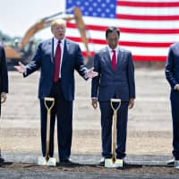 U.S. President Donald Trump, second left, speaks as Scott Walker, governor of Wisconsin, (from left), Terry Gou, chairman of Foxconn Technology Group, and Speaker Paul Ryan, a Republican from Wisconsin, listen during the groundbreaking ceremony for the Foxconn facility in Mount Pleasant, Wisconsin, on June 28. Trump has praised the Taiwanese company for bringing jobs to a state critical to his re-election. | BLOOMBERG