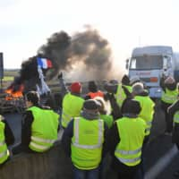 'Yellow vest' protests block fuel depots in France, as retailers feel the pinch