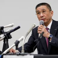 Nissan Motor Co. President and Chief Executive Officer Hiroto Saikawa speaks during a news conference Monday evening at the carmaker's headquarters in Yokohama after Chairman Carlos Ghosn was arrested on suspicion of underreporting his salary. | REUTERS