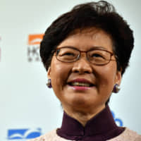 Carrie Lam, chief executive of the Hong Kong government, speaks at a symposium in Tokyo on Thursday.   YOSHIAKI MIURA