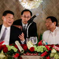 After Chinese leader's visit, Philippine ministers meet Japan PM's aide to advance infrastructure plans
