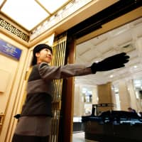 Yuria Nagamoto is an elevator operator at Takashimaya Co.'s Nihonbashi department store in central Tokyo. | REUTERS