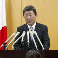 Economic revitalization minister Toshimitsu Motegi holds a news conference on Wednesday in Tokyo to announce that the CPTPP will take effect on Dec. 30. | KYODO