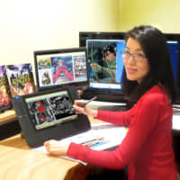 Comic activism: Queenie Chan digitally draws a picture of Little Red Riding Hood at her desk in Sydney. | COURTESY OF QUEENIE CHAN