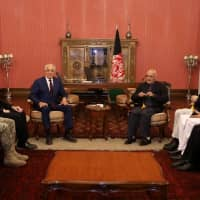 Afghan President Ashraf Ghani (rear right) and U.S. special envoy for peace in Afghanistan, Zalmay Khalilzad, (rear left) meet in Kabul on Nov. 10. | REUTERS