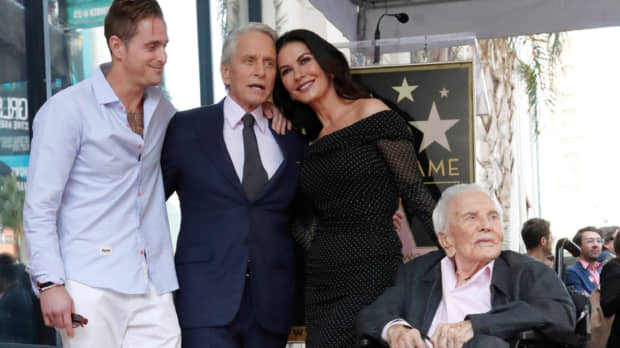 Michael Douglas fetes 50th year in show biz, joins dad Kirk with star on Hollywood Walk of Fame