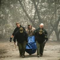Death toll rises to at least 23 in California wildfire after 14 bodies found