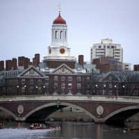 Rowers practice on the Charles River, past the campus of Harvard University in Cambridge, Massachusetts, in March 2017. | AP
