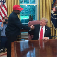 President Donald Trump meets with rapper Kanye West in the Oval Office on Oct. 11. | AFP-JIJI