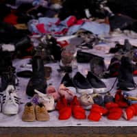 Recovered shoes believed to be from the crashed Lion Air flight JT610 are laid out at Tanjung Priok port in Jakarta Thursday. | REUTERS
