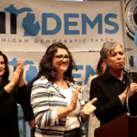 Democratic U.S. congressional candidate Rashida Tlaib (center) attends a midterm campaign rally with Democratic nominee for governor Gretchen Whitmer (left) and U.S. Congresswoman Brenda Lawrence in Detroit Sunday. | REUTERS