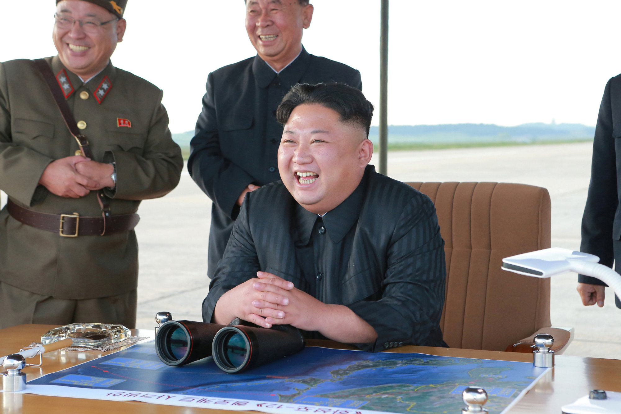 North Korean leader Kim Jong Un guides the launch of a Hwasong-12 missile in this undated photo released last September. | REUTERS