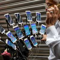 Taiwan grandpa catches 'em all playing 'Pokemon Go' on 15 phones