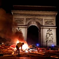 Grassroots protest against gasoline tax turns into biggest challenge yet for France's Emmanuel Macron