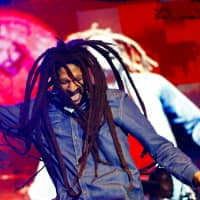 Julian Marley, son of the late reggae icon Bob Marley, performs at a concert celebrating his father's 69th birthday at the National Stadium in Kingston in 2014. | REUTERS