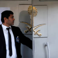 A member of the security staff stands at the entrance of the Saudi Arabian Consulate in Istanbul on Oct. 29. | REUTERS