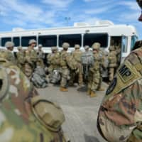U.S. soldiers arrive at Valley International Airport in Harlingen, Texas, to conduct the first missions along the southern border in support of Operation Faithful Patriot on Thursday. | AFP-JIJI