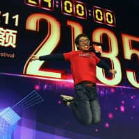 China's Alibaba nets record $30 billion in Singles' Day sales extravaganza, but growth rate plunges