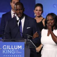 Democratic Florida gubernatorial candidate and Tallahassee Mayor Andrew Gillum concedes the Florida governor's race to U.S. Rep. Ron DeSantis as Gillum's wife, R. Jai, wipes away tears and his running mate Chris King and King's wife, Kristin, look on at his midterm election night rally in Tallahassee on Tuesday. | REUTERS