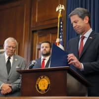 Republican gubernatorial candidate Brian Kemp appears with Georgia Gov. Nathan Deal (left) on Thursday in Atlanta. | AP