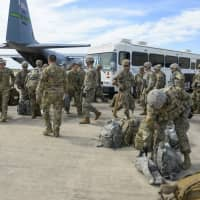 Soldiers from the the 89th Military Police Brigade, and 41st Engineering Company, 19th Engineering Battalion, Fort Riley, Kansas, arrive at Valley International Airport Thursday in Harlingen, Texas, to conduct the first missions along the southern border in support of Operation Faithful Patriot. The soldiers will provide a range of support, including planning assistance, engineering support, equipment and resources to assist the Department of Homeland Security along the Southwest border.   ALEXANDRA MINOR / U.S. AIR FORCE / VIA AP