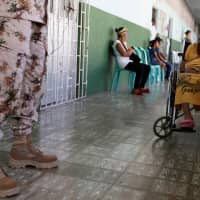 Patients wait to be attended by staff of the United States Navy hospital ship USNS Comfort at the Divina Pastora high school in Riohacha, Colombia, Monday. | REUTERS