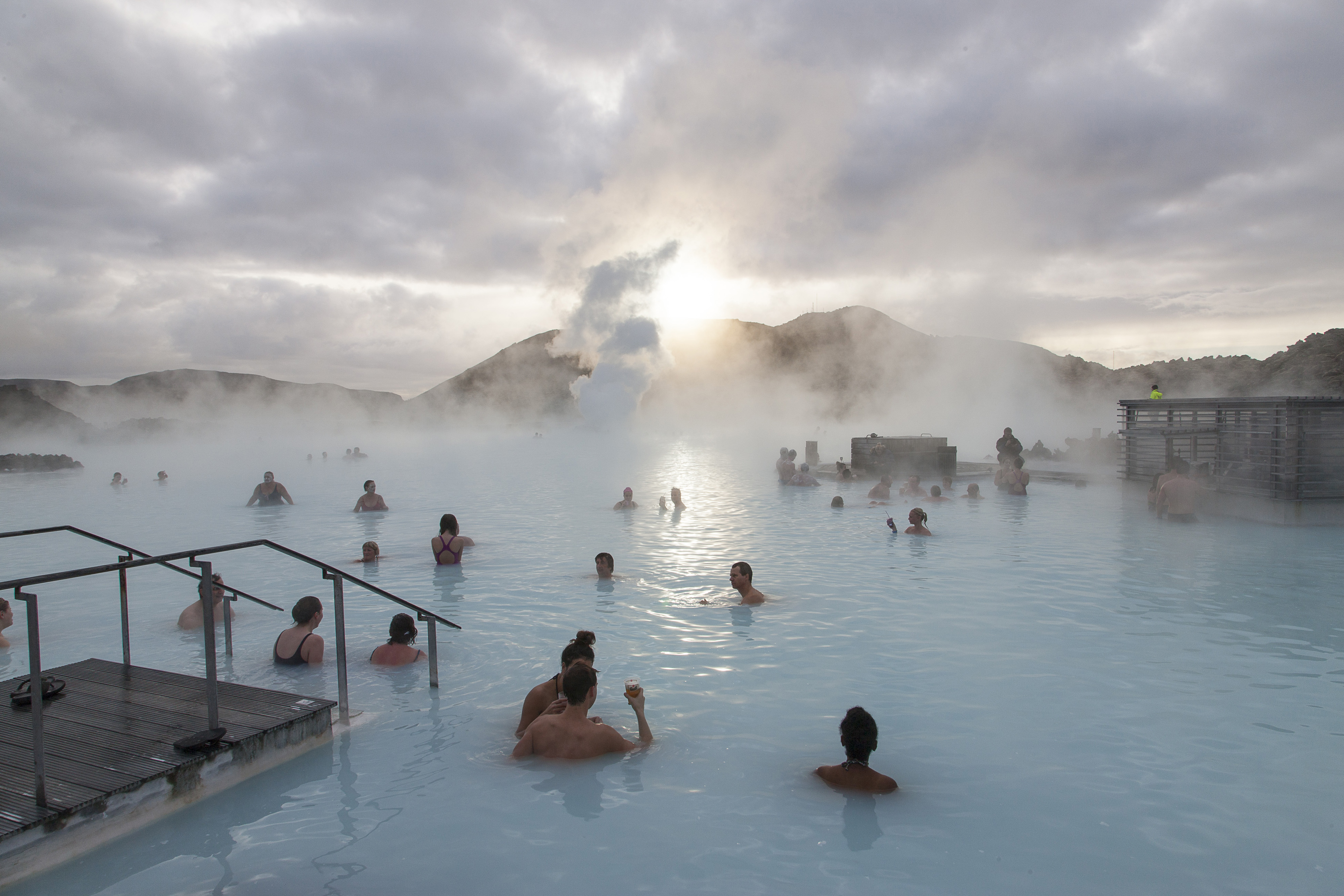 Tourists bathe in the Blue Lagoon geothermal spa in Grindavik, Iceland.   BLOOMBERG
