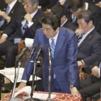 Prime Minister Shinzo Abe speaks during a House of Representatives Budget Committee meeting Thursday.   KYODO