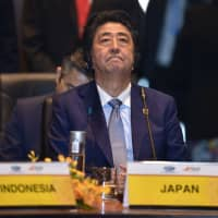 Prime Minister Shinzo Abe attends the Pacific Islands Countries Informal Dialogue with leaders at the Asia-Pacific Economic Cooperation summit in Port Moresby on Saturday. | AFP-JIJI