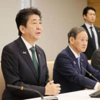 In Tokyo on Tuesday, Prime Minister Shinzo Abe speaks at a government committee meeting regarding ceremony arrangements for the ascension of the new Emperor. | KYODO