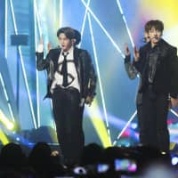 The talent agency that represents South Korean boy band BTS, seen here performing in Incheon earlier this month, issued an apology Tuesday, addressing the controversial attire worn by members. | KYODO